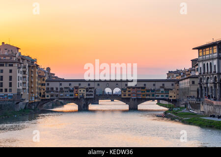 Sunset view at Ponte Vecchio the old bridge in Florence, Tuscany, Italy. - Stock Photo
