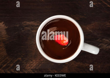 Overhead photo of strawberry in chocolate, with copyspace - Stock Photo