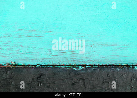 Two-tone wooden background consisting of turquoise color with black. - Stock Photo