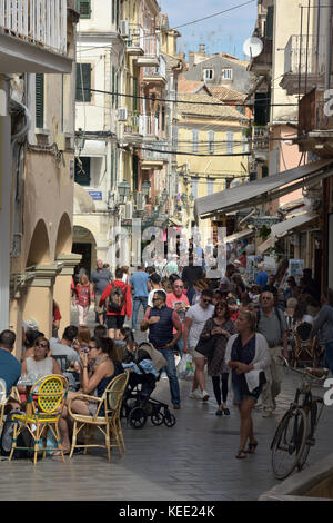 a crowded side street or back alley in the tourist attraction of the old town in Kerkira on corfu in Greece with - Stock Photo