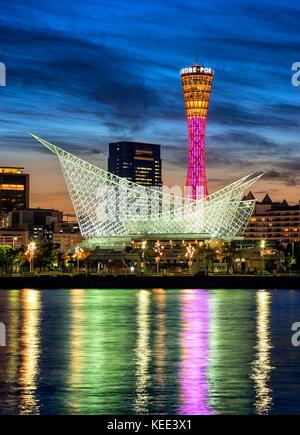 Japan, Honshu island, Kansai, Kobe, Port Tower and Meriken Park at dusk. - Stock Photo