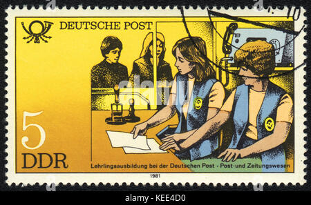 A postage stamp printed in DDR shows Training personnel to work c mailings, from series Postal History of Germany, - Stock Photo