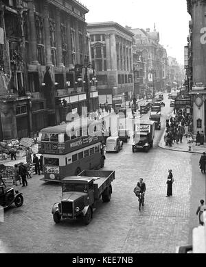 Oxford Circus, London c1942. Life going on as normal despite the effects of a bombing during World War 2, people - Stock Photo