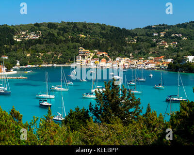 Yachts at anchor in the pretty and popular Lakka Bay, Paxos, Greece - Stock Photo