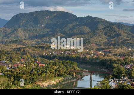 Top view of Luang Prabang from Phousi Mountain during sunset. - Stock Photo