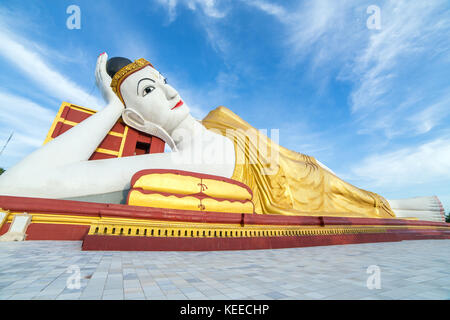 Giant Reclining Buddha at the Maha Bodhi Tataung in Monywa Myanmar. - Stock Photo