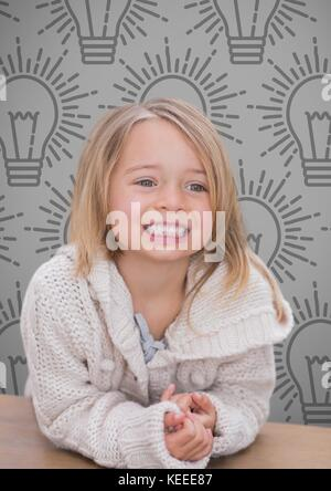 Digital composite of Blonde Girl against grey background with warm jumper and light bulbs - Stock Photo