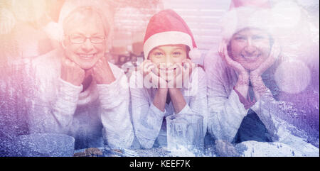 Snowy pine trees on alp mountain slope against multi-generation family baking together - Stock Photo