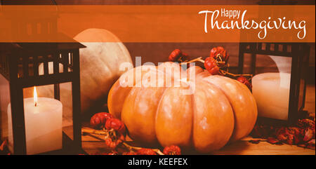 Illustration of happy thanksgiving day text greeting against pumpkins with candles on table during halloween - Stock Photo