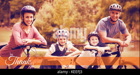 Digital image of happy thanksgiving day text greeting against happy family on bicycle at park - Stock Photo