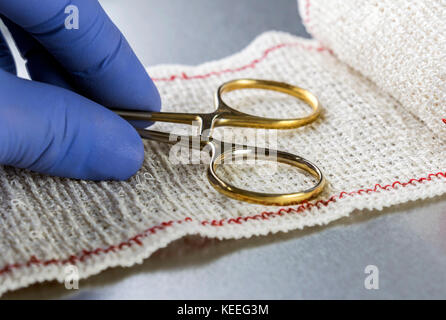 Surgical Scissors On A Bandage, Conceptual Image - Stock Photo