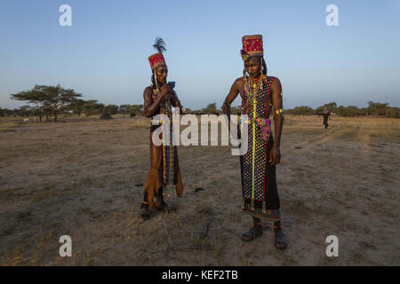 Chad. 27th Sep, 2016. Two Wodaabe men take a break from dancing to catch their breath. The Gerewol festival is a grueling test of endurance for the men, who dance for hours in stifling heat in the hopes of impressing a woman. Credit: Tariq Zaidi/ZUMA Wire/Alamy Live News