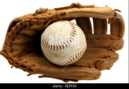 Close up of a rustic old baseball mitt with a hardball in the pocket.  On white.