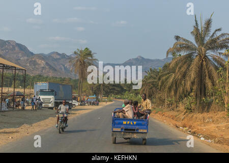 SUMBE/ANGOLA 10 OCT 2017 African family to travel by motorcycle. Angola. - Stock Photo