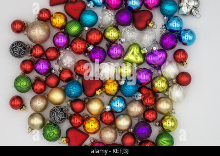 Christmas Background Theme. Multicolored Christmas Balls Red, Blue, Green, Silver, Gold, Purple, Yellow On a white - Stock Photo
