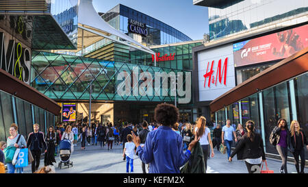 People walking on the footbridge walkway from Stratford Station East London the Westfield Shopping Centre, London, - Stock Photo