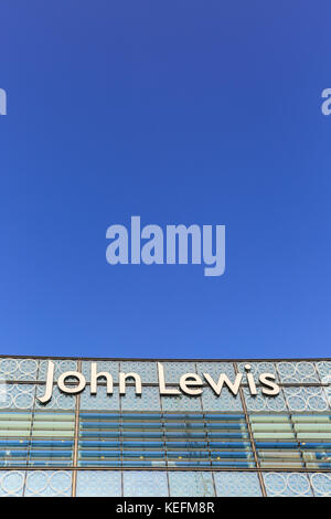 John Lewis store sign and corporate branding outside the department store branch in Westfield Stratford, London - Stock Photo