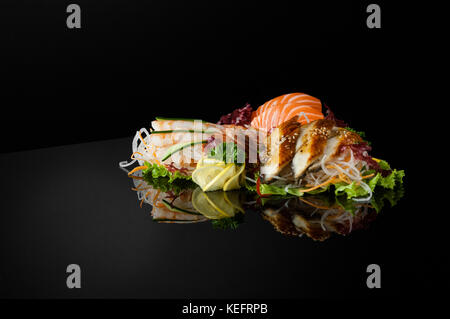 a set of sushi with shrimps on a black background with reflection - Stock Photo