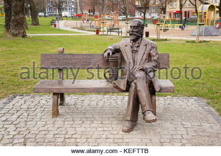 Statues of a sitting man at a park in Poznan, Poland - Stock Photo