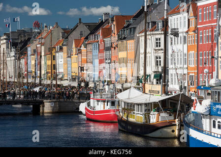Nyhavn (New Harbour) is a 17th-century waterfront, canal and entertainment district in Copenhagen, Denmark,  It - Stock Photo