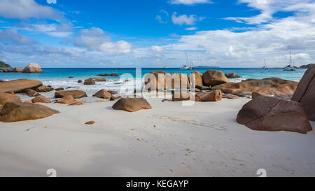 Catamarans at anse lazio on the seychelles. Turquoise water, granite rocks in the white sand on paradise beach - Stock Photo