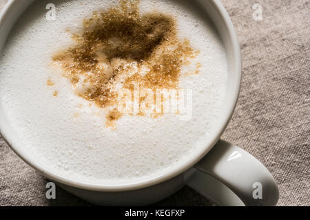 Frothy coffee in a white mug 20 October 2017 PHILLIP ROBERTS - Stock Photo