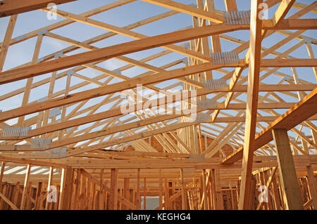 Framed house roof during construction - Stock Photo