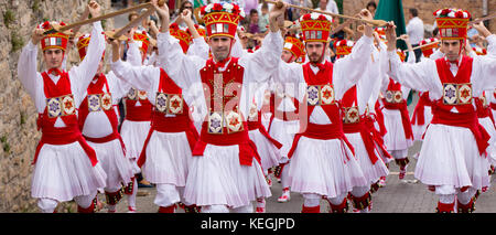 Dancers in procession through the streets during San Fermin Fiesta at Pamplona, Navarre, Northern Spain - Stock Photo