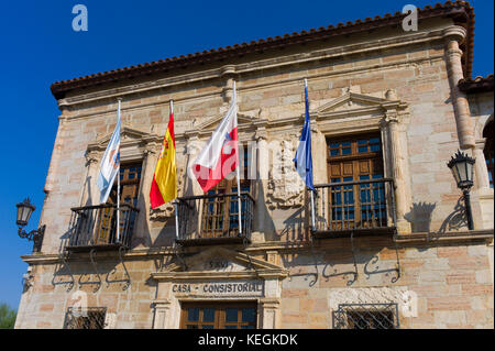 Ayuntamiento, County Hall, 16th Century with flags of Cantabria, Spain and EU in San Vicente de la Barquera, Northern - Stock Photo