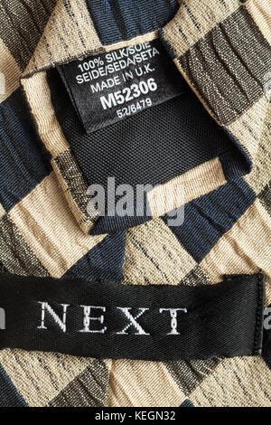Next label in tie 100% silk Made in U.K. - Stock Photo
