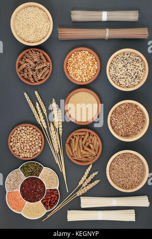 Dried macrobiotic super food with japanese soba and udon noodles, legumes, seeds, grains and whole wheat pasta, - Stock Photo