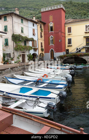 Cassone, Lake Garda, Italy. Picturesque view of the village Cassone, with the harbour in the foreground. - Stock Photo