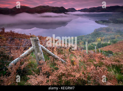 Into the Mist, Ullswater at Dawn from Gowbarrow Fell, Lake District National Park, Cumbria, England, UK - Stock Photo