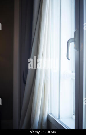 ... Luxury Hotel Bedroom Window With Curtains Drawn Back.   Stock Photo