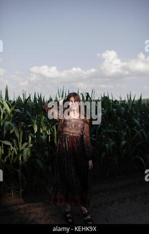 Caucasian woman standing in cornfield - Stock Photo