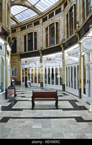 Shops in Royal Arcade shopping centre, Worthing, UK - Stock Photo