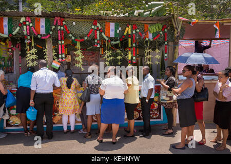 The Seychelles, Mahe, Victoria, India Day, queue of customers outside Copper Pot Indian food stall - Stock Photo