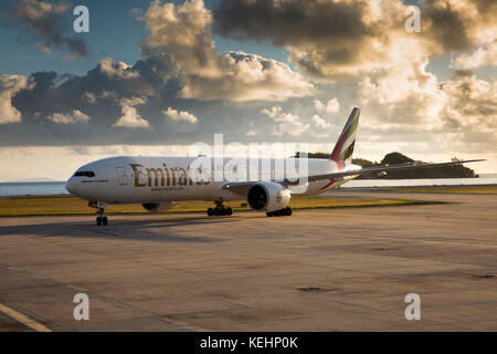 The Seychelles, Mahe, Airport, Emirates Airlines Boeing 777-300ER aircraft taxiing at dawn - Stock Photo