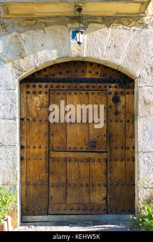 Traditional Basque architecture with studded wooden door near Orozko in the Biskaia Basque region of Northern Spain - Stock Photo