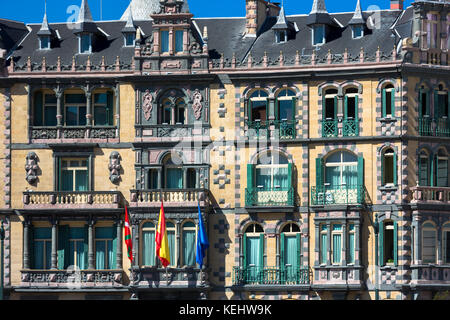 Basque, Spanish and European Union EU flag on Delegation of the Government in Bizkaia at Plaza Moyua in Bilbao, - Stock Photo