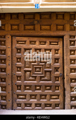 Wooden doorway in Santo Domingo de La Calzada on the Way of St James pilgrim route Camino de Santiago in Castilla - Stock Photo