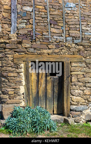 Old barn in mountain village of Somaniezo in Picos de Europa region, Cantabria, Northern Spain - Stock Photo