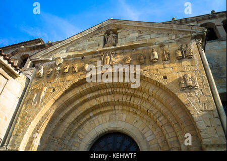 Doorway of Colegiata Santillana, St Juliana's Collegiate Church, in Santillana del Mar, Cantabria, Northern Spain - Stock Photo