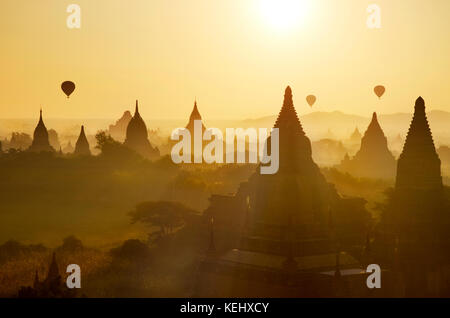 Sunrise at Bagan with hot air balloons, Myanmar, Asia. - Stock Photo