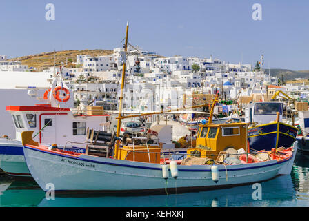 Fishing boats in the pretty port of Naoussa on the island of Paros, Cyclades, Greece - Stock Photo