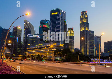 Singapore city sunset over the Jubilee Bridge and the skyscrapers of the downtown CBD, Singapore - Stock Photo