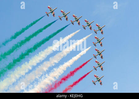 Frecce Tricolori, Italian national air patrol, flying in formation during air show with tricolor smoke - Stock Photo