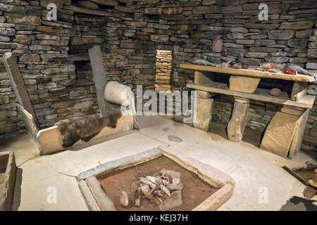 Replica of the interior of a stone house at the Neolithic settlement of Skara Brae, Mainland, Orkney, Scotland, - Stock Photo