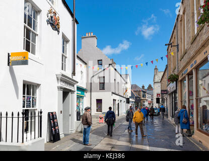 Shops on Albert Street in the town centre, Kirkwall, Mainland, Orkney, Scotland, UK - Stock Photo