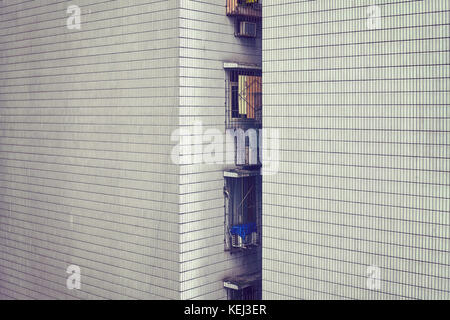 Vintage toned picture of an old apartment building tiled wall, urban background, Chongqing, China. - Stock Photo